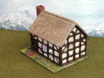 Square timber framed wattle & daub cottage
