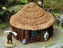 Timber/wattle hut with conical pattern thatch roof