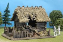 Damaged Thatch Roof / Slotted Timber Cabin