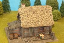Large Plank House With Coarse Thatch Roof
