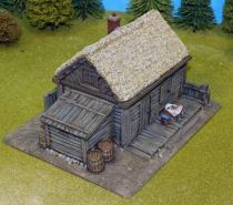Large Plank House With Smooth Thatch Roof