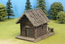 Small Log Cabin With Wood Shelter