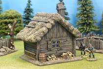 Small Plank Cabin With Thatch Roof