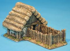 Thatched pig shelter